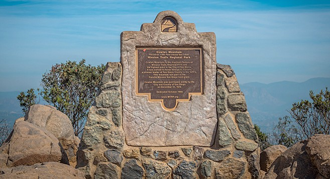 The monument at the top honors pioneer George A. Cowles.