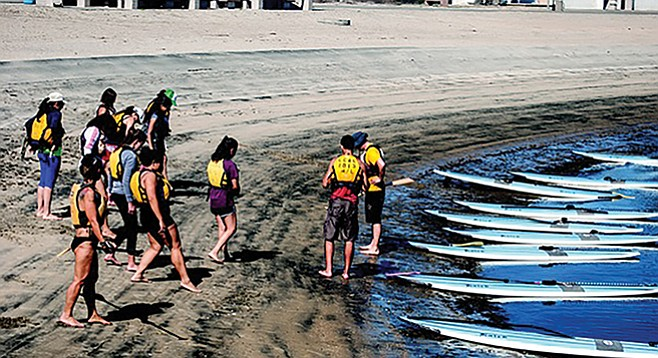 Students, mount your stand-up paddleboards (Crown Cove)