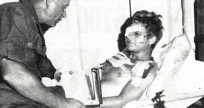 "Author receiving Purple Heart from Army General Stillwell. You're sure your leg is blown off, has to be, one arm doesn't work your ""good"" hand...part of your finger missing, grab your face...nothing...."