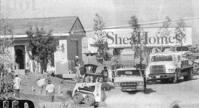 "Construction site of Shea Homes, Encinitas. The sign at Via Cantebria that, in early 1998, advertised homes selling ""from the high three hundreds"" now said ""from the mid-four hundreds."""