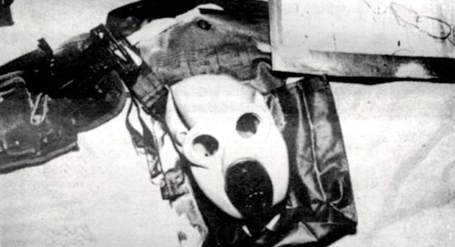 """Nuclear-biological-chemical mask. """"The stuff is still coming into our railroad depot on flatcars."""""""
