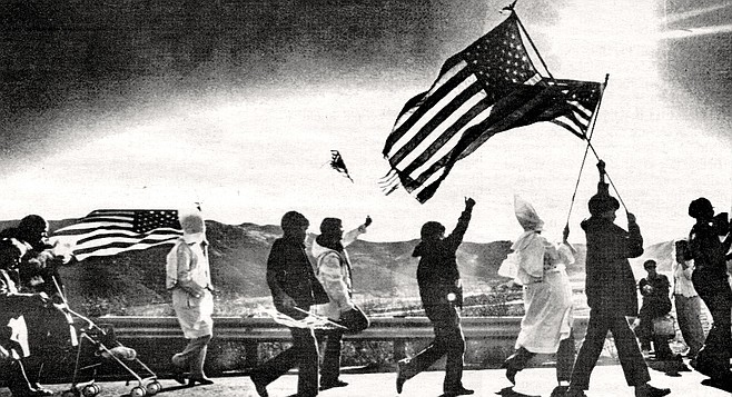 Klan members greeted by hecklers on their march to San Pasqual monument, January 20, 1980. Metzger staged a commemoration of Kit Carson, a man he praised for his valor against Mexican soldiers.