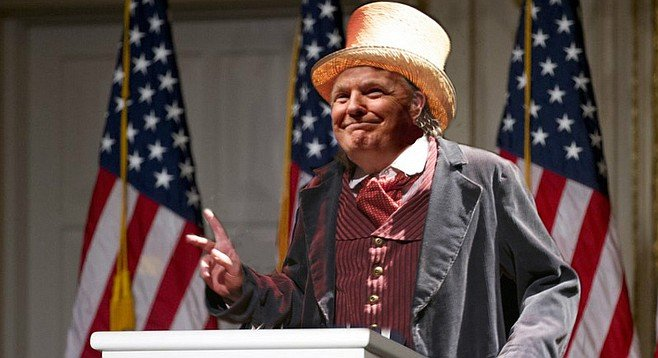 "Trump addresses members of the press dressed as the Dauphin from Huckleberry Finn. ""Was Twain's Dauphin really the heir to the throne of France? Who cares? What matters is that he was a great American: someone with the courage to write his own narrative and make his own history. Someone with the guts to take risks to get what he wanted. Americans don't want honesty from their leaders; I think the past 100 years have made that pretty clear. What they want is results, and a good story to go along with them. And that's what I can provide, just like what the Dauphin provided Huck."" When a reporter pointed out that the Dauphin was eventually tarred and feathered for his swindles, Trump replied that it was probably the work of religious extremists ""who have no place in this great nation, then or now."""