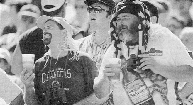 Fans at Chargers-Ravens game, September 28, 1997. Most things on television are moronic and violent, but these players aren't actors; the violence is real and we are invited to participate.