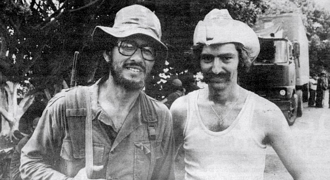 "MacRenato (left) with journalist Dave Helvarg in Nicaragua, 1979. MacRenato encountered political tourists who became known as ""Sandalistas"" and were thoroughly despised by the people."