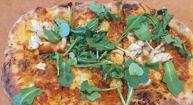 Romesco, cauliflower, and manchego pizza