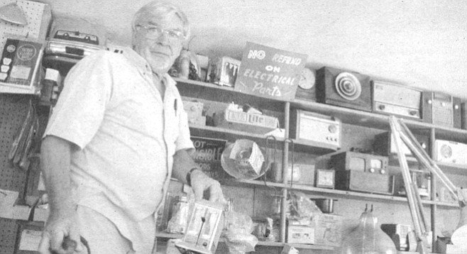 Tom Jones at his Mission Hills repair shop: clock radios, coffeemakers, water filters, vaporizers, humidifiers, computer manuals, an ice cream maker, an Electro-Lux vacuum-cleaner cylinder that is so old it looks like something from Jules Verne's imaginary sketchbook, electric frying pans, racks of extension cords, floppy disks, light bulbs, an electric hot-dog cooker.