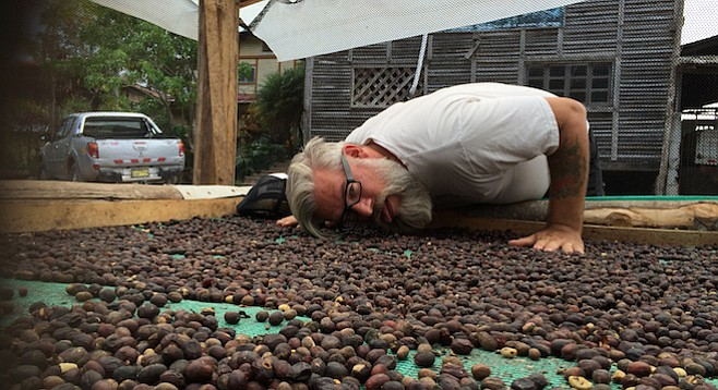 Coffee Spanish author Andy Newbom investigates coffee process during a coffee buying trip.