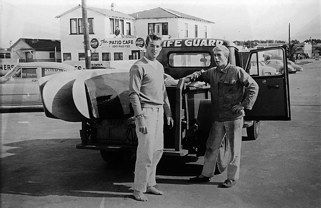 Lifeguards Chuck Quinn and Tom Carlin waiting to surf with Dempsey Holder. Winter, 1952, Imperial Beach