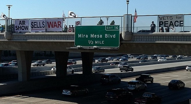Anti-air show banners hung along I-15 northbound on Thursday, August 18