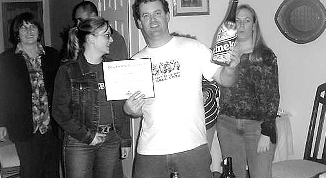 Rob holding diploma