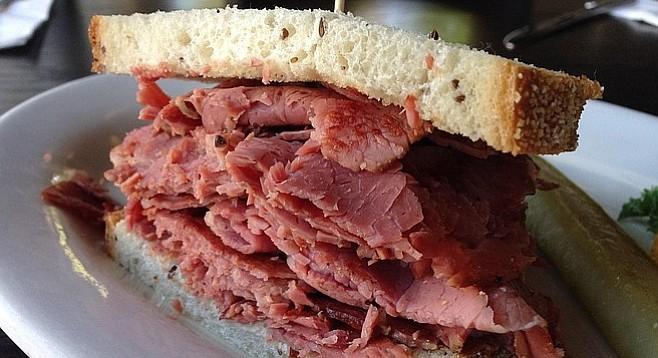 """Corned beef piled high on an """"overstuffed"""" sandwich"""