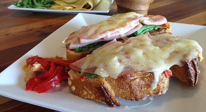 Bread & Cie sourdough topped with ham, red-pepper hummus, spinach, and Gruyère