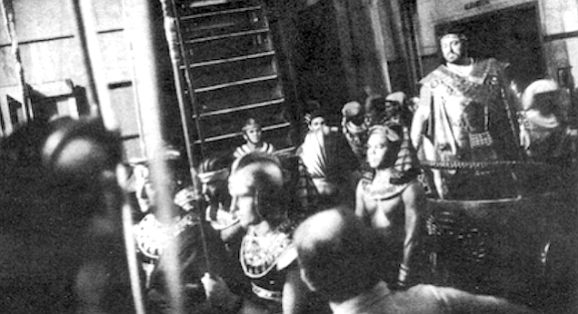 Astride a chariot backstage, Luciano Pavarotti awaits his entrance in Aida's grand march (1981)