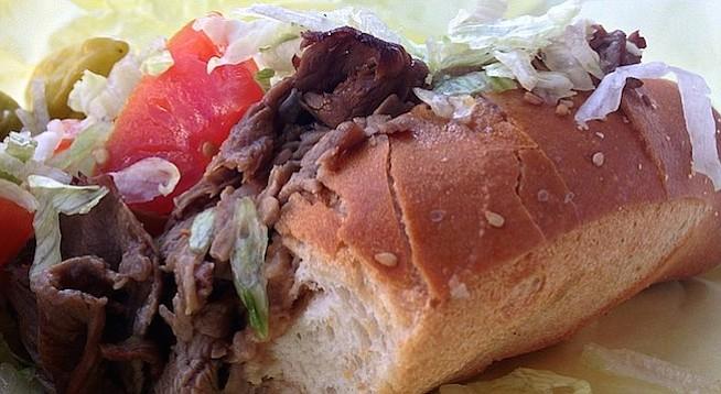 Au jus seeps into a crispy toasted roll of Poma's juicy roast beef sandwich