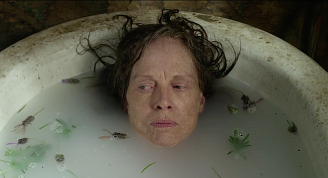 Judy Davis as Madcap Molly taking a long overdue bath in The Dressmaker.