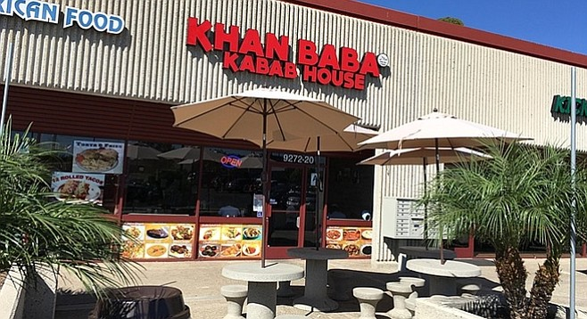 A strip mall storefront restaurant serving Indian and Pakistani food.
