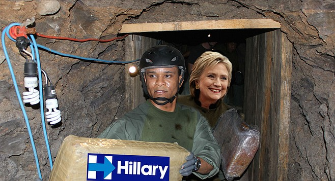 """Hillary Clinton smilingly carries a bag of """"imported Colombian coffee"""" through one of the Juarez Cartel's many tunnels between the United States and Mexico as a sign of friendly trade relations to come. """"I was really touched by her willingness to actually get down under the ground and walk with us,"""" says tunnel rat Ernesto Cabrillo, pictured. """"I'm not a citizen of the United States, and also a convicted felon, but she's definitely getting my vote."""""""