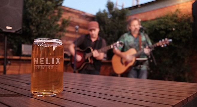 The Setting Sons duo plays a show in the beer garden at helix Brewing Co. in La Mesa.