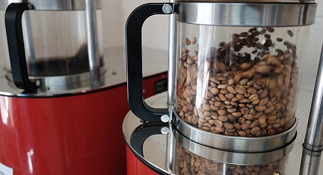 Coffee beans are tossed and heated by hot air in a fluid bed roaster at David's Roasting.