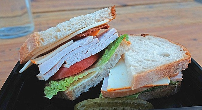Thick cuts of turkey and tomato make this simple sandwich a bargain.