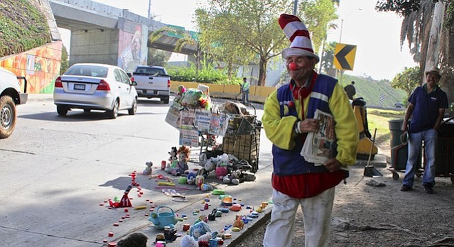 A trail of toys and other plastic items marks Pepe Nacho's sales territory.