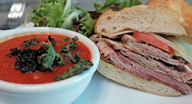 Two kinds of pork offer differing flavor profiles that work well together in a Cubano, seen here with tomato soup