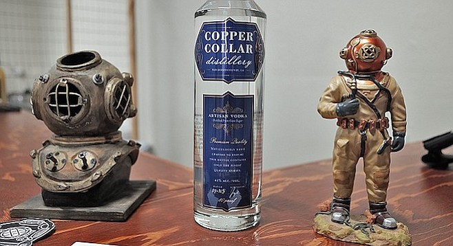 The copper collar connects the diving helmet to the diving suit in these old Navy diver rigs.