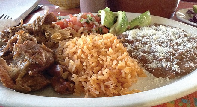 At El Pachanguero, carnitas with rice and frijoles go down easy