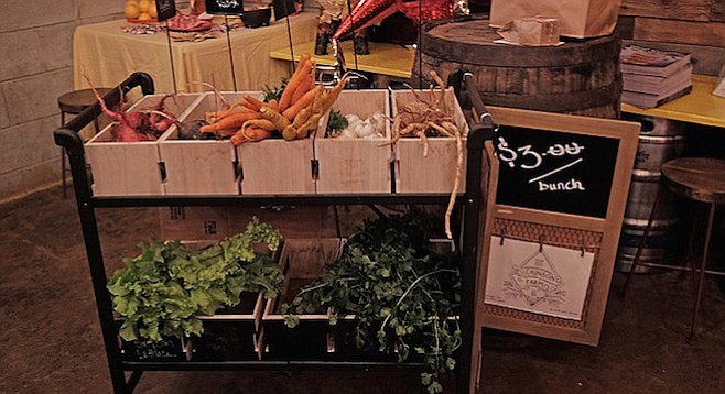 The small farmers' market stand appearing at Machete Beer House Monday nights from 7 to 9 p.m.