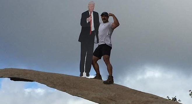 Donald Trump cardboard cutout and friend