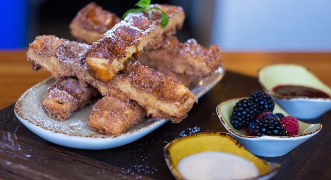 Waffled Churro Sticks with maple cream cheese sauce, blackberry jam, and fruit