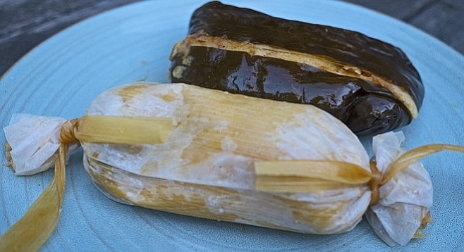 That's a corn husk tamal with pork in front, and an equally greasy chicken platano in the back.