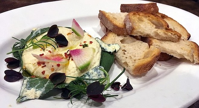 The baked ricotta appetizer looked better than it tasted, garnished with sorrel, sea grass, and watermelon radish