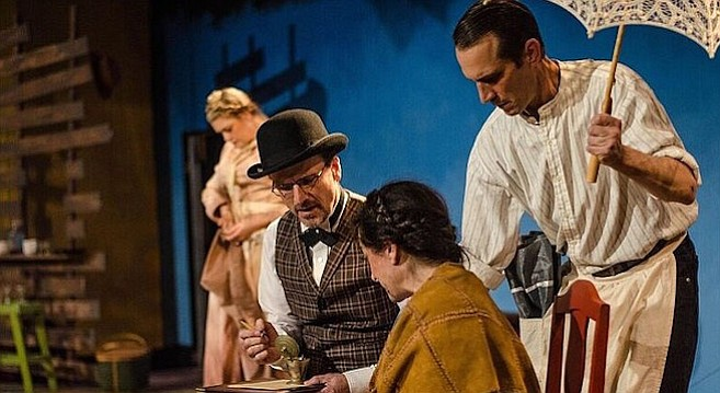Jacque Wilke, David Raines, Jessica John, and Francis Gercke (with umbrella) search for the elephant in Moxie Theatre's Abundance