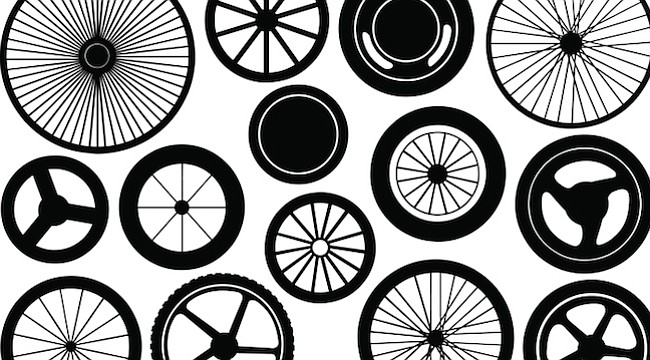 Wheels of every sort — rollerskates, taxis, bicycles, motorcycles, semi trucks, RVs, buses, and skateboards