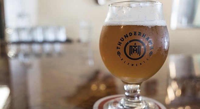 A glass of New Thunder Cyderweiss, a collaboration between cider maker Newtopia Cyder and beer producer Thunderhawk Alements.