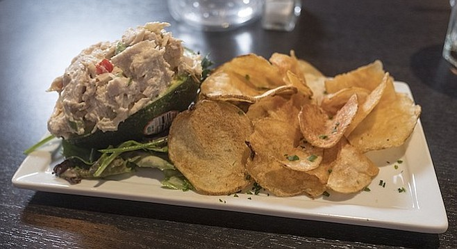 Chicken salad stuffed avocado with house-made potato chips