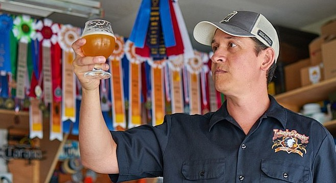 Nick Corona continues to amass award ribbons with his tasty homebrew. Photo by Tim Stahl.