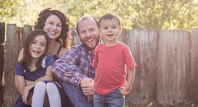 Daughter Tayla, wife Abbey, Tim Cain, and son Malachi