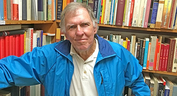 John Drehner looked for a few tomes to add to his 12,000-book collection.