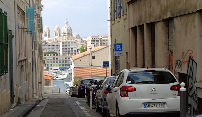 Narrow Marseille streets offer views of the harbor and monuments.