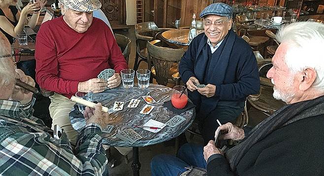 """Four regular customers playing """"Scopa,"""" the card game of Italy's cafes"""