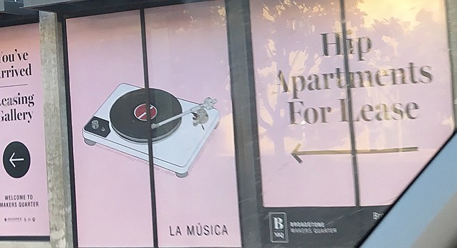"The ""Hip apartments for lease"" sign"