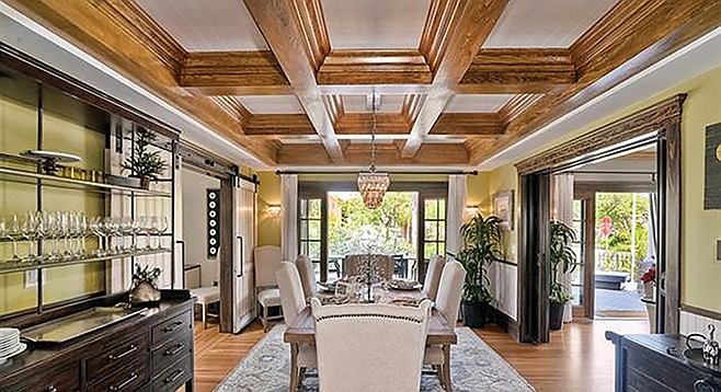 Empty your coffers and become the owner of this sweet coffered ceiling.