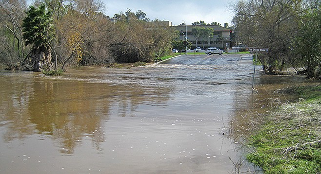 San Diego River flows over Avenida Del Rio in 2010. Typically, Mission Valley flooding is more of a traffic hassle than an aquatic apocalypse.