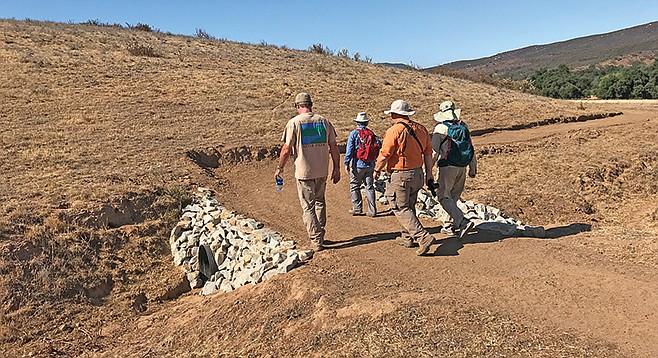 Walking along the newly developed trail