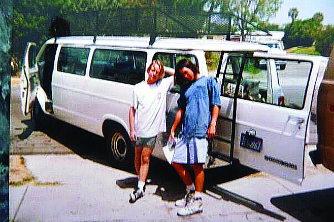DeLeon and a friend get ready to go to work, 1990.