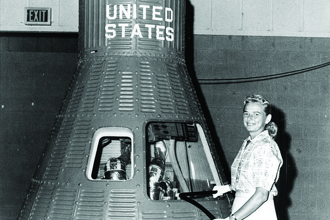 Jerrie Cobb next to the Mercury capsule