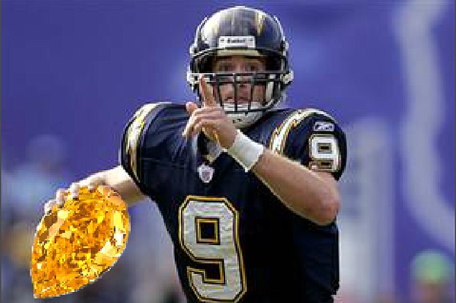 Tripped up: Drew Brees, shown here in happier times. wearing Charger Blue, holding up a finger indicating his future as the number one passer of all time, and carrying a yellow diamond he thought was a lot more valuable than it turned out to be.
